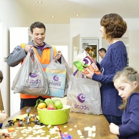 Coles enters e-commerce big leagues with leading British online grocer Ocado