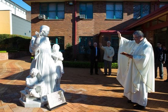 Alumni funded statues blessed at Ashfield