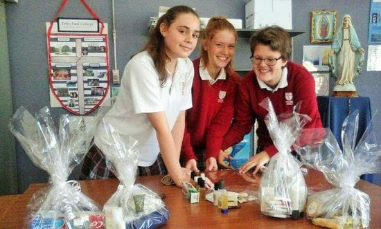 John Paul College students pack Christmas Packs for Women's Refuge