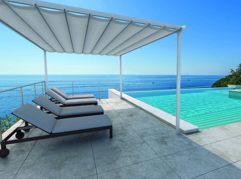 Surya Retractable Roofing Awnings look great poolside freestanding or attached to a wall. Manual operation with range of colours