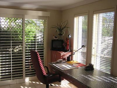 Plantation Shutters and Timber Look Venetian Blinds in the same room