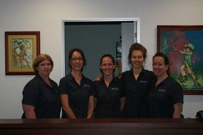Periodontics & Dental Implant Centre reception staff
