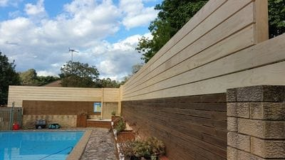 Raised this pool boundary fence by 900mm with dressed slats