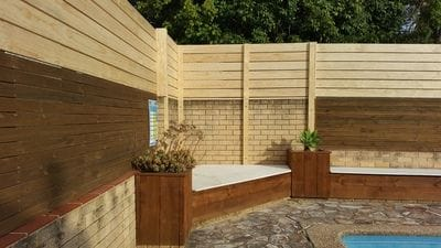 Raised this pool boundary fence 900mm with dressed slats
