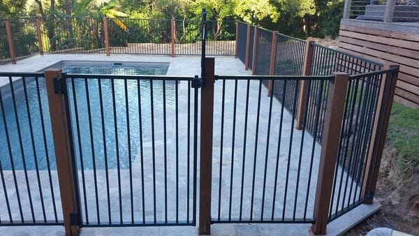 Merbau posts & charcoal tubular alum pool fence