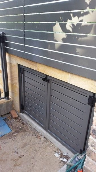 3-woodland-grey-alum-slat-gates-under-patio