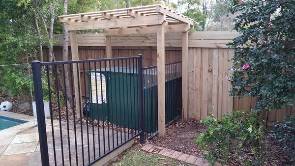 pergola over climbable pool filter box on boundary fence