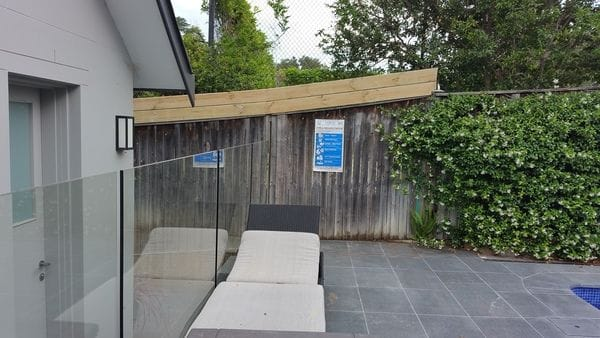 sawn-timber-slats-to-raise-pool-boundary-fence