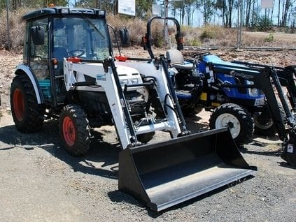 New Holland Tractor (40HP) with 5 Ft slasher and front loading bucket