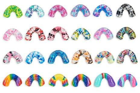 mouth guards laid out in rows