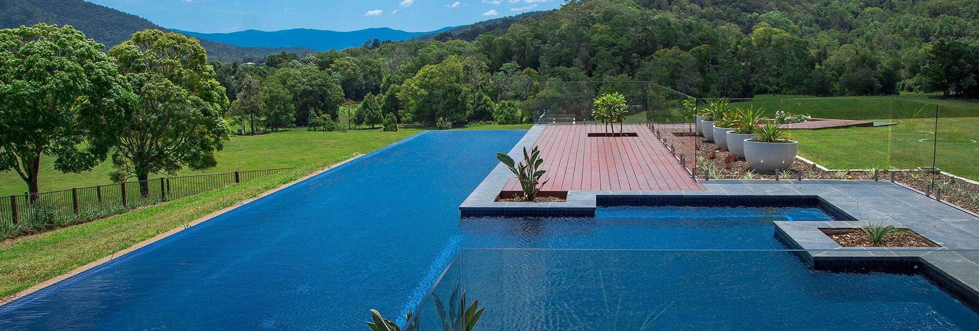 Swimming pool builders award winning concrete pools for Pool design website