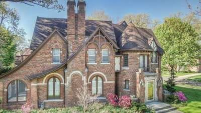 Sherwood Forest Tudor with stunning facade lists for $460K