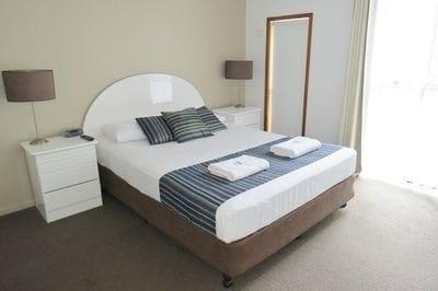 Queen size bed in large bedroom