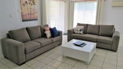 Spacious living room with twin sofas