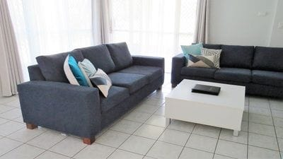 Deluxe Villa living room with two large navy sofas