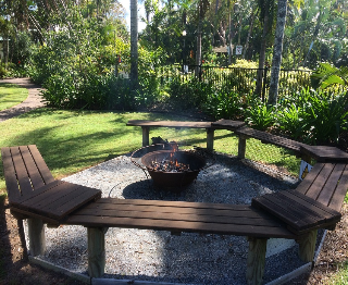 Bench seating surrounding a wood fire pit