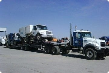 Heavy Equipment Transport in the Winter with Tilt and Load Trucks and Float Trailers