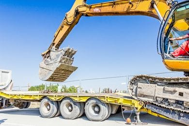 Simplify Your Next Construction Project with a Tilt and Load Truck Rental