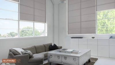 Sunway Quantum Roller Blind, fitted in living room setting. Textured translucent fabric covers windows allowing light in but maintains privacy.