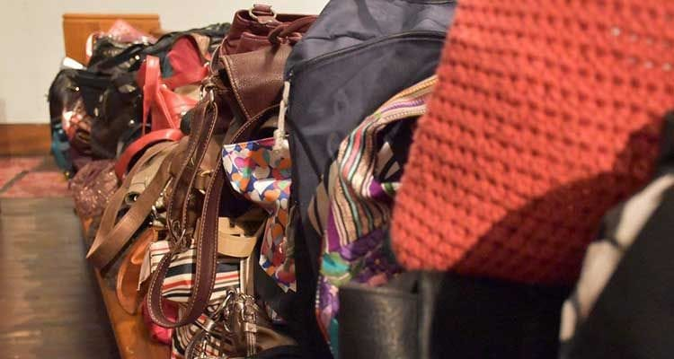 purses filled with tampons, pads and feminine hygiene products