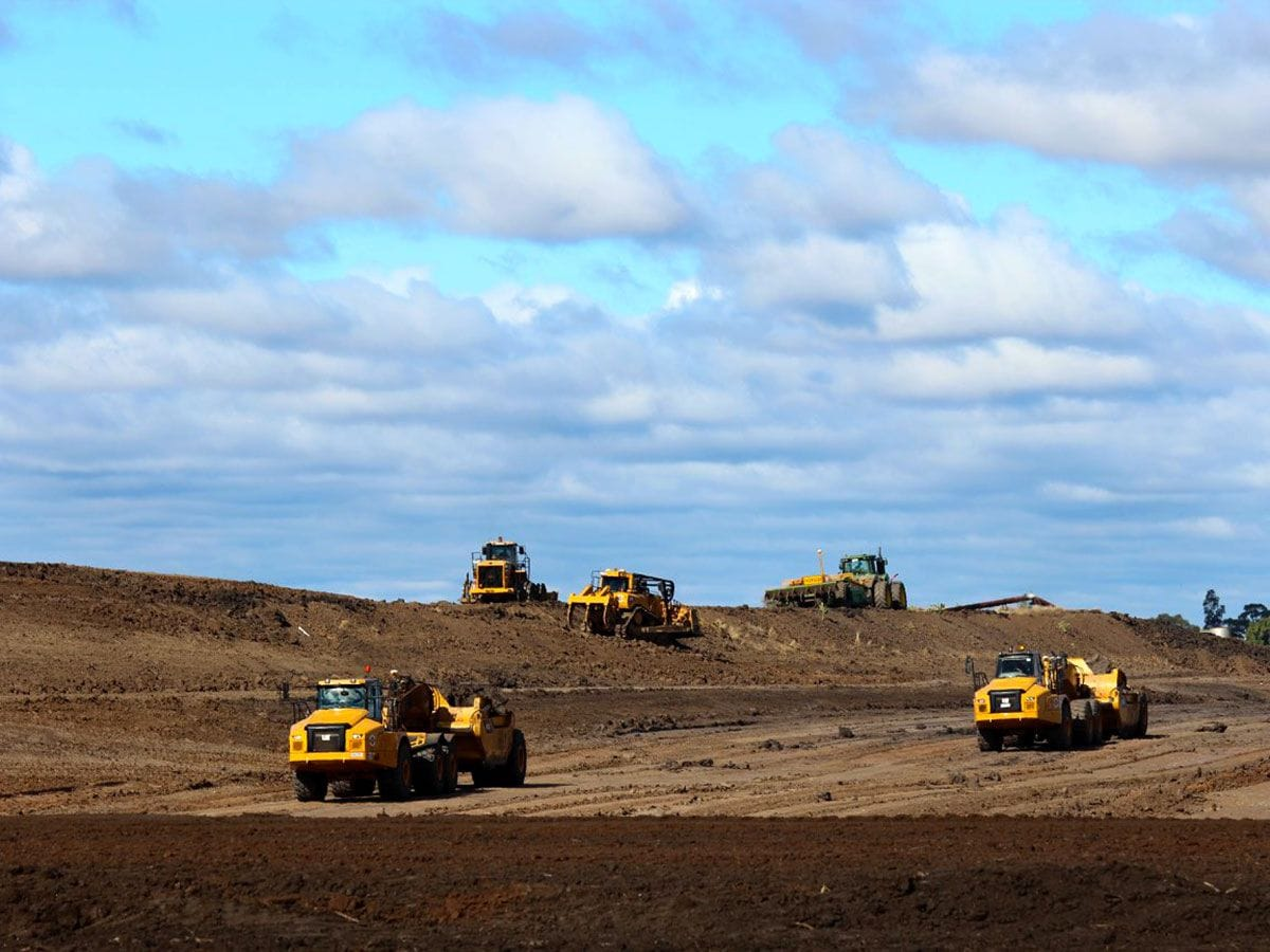 5 peices of earthmoving equipment hard at work in south west queensland