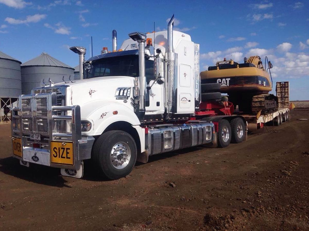 Semi trailer with a track driven dozer loaded and ready for transport