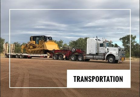 Semi trailer loaded with heavy equipment ready for transport