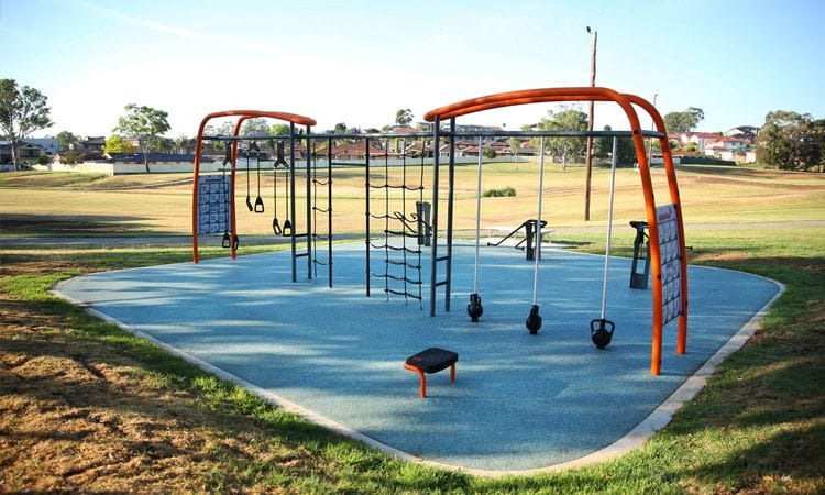 Synthetic Grass and Rubber | Rubber Wetpour Outdoor Fitness Station