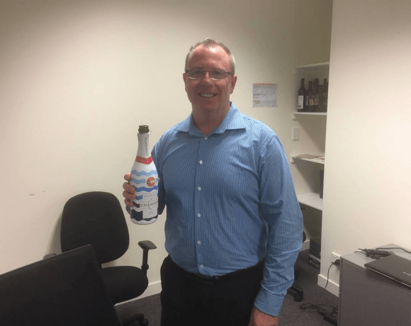 Dan Fox popping the champagne to celebrate our wholesale funding facility