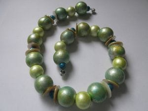 Hand-painted wooden beads with turquoise stones and shell discs