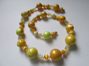 Hand-painted wooden beads with fancy glass flowers and yellow miracle
