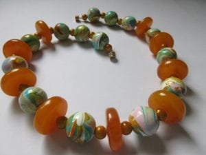 Hand-painted wooden beads with amber discs and miracle beads