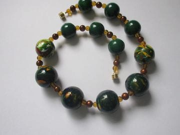 Hand-painted wooden beads with brown miracle glass beads
