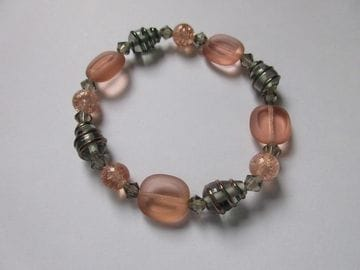 Rose coloured cracked glass, fancy metal smoke wrapped glass and Czech crystals
