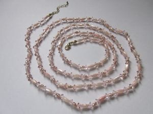 Fresh water pearls in soft pinks, Czech crystals with clasp