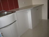 laundry benchtop and storage cupboards