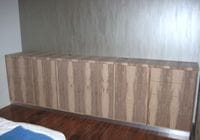 storage unit in timber veneer with push catch drawers and doors