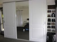 Sliding 2 panel Colonial doors with 2 pak finish