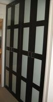 Hinged doors with white glass inserts