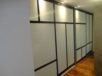 Sliding doors with white glass panels & 100mm Polytec Black Wenge border