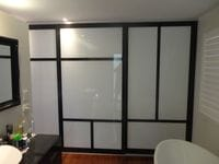 Sliding doors with 100mm Polytec Black Wenge border with opaque white glass inserts