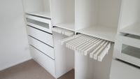 White melamine walk in robe, 2 x trouser racks, clear glass drawer fronts
