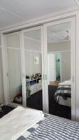 Sliding doors with 100mm boarder and mirror glass inserts, recessed handles