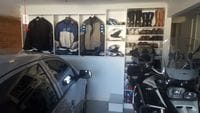 Garage storage for motor cycle and cycling gear