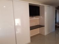 Robe either side of TV with Gloss white MR MDF sliding doors