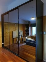 Dark grey mirror sliding doors with black MR MDF end wall