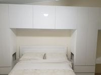Surround bed storage with cutout side tables