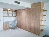 Study with hinged doors & angled shelving
