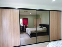 Black framed bronze mirror and Polytec Natural Oak Matt sliding doors