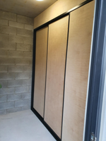 Black framed Marine grade ply sliding doors with bulkhead